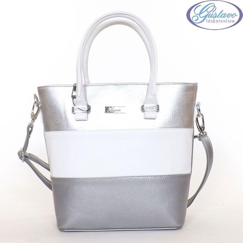 a42b1d2993d4 Karen rostbőr női divattáska ezüst színű anyagból készült a hátulja. Az  eleje ezüst és fehér színű. Magasabb fazonú, merev falu táska.